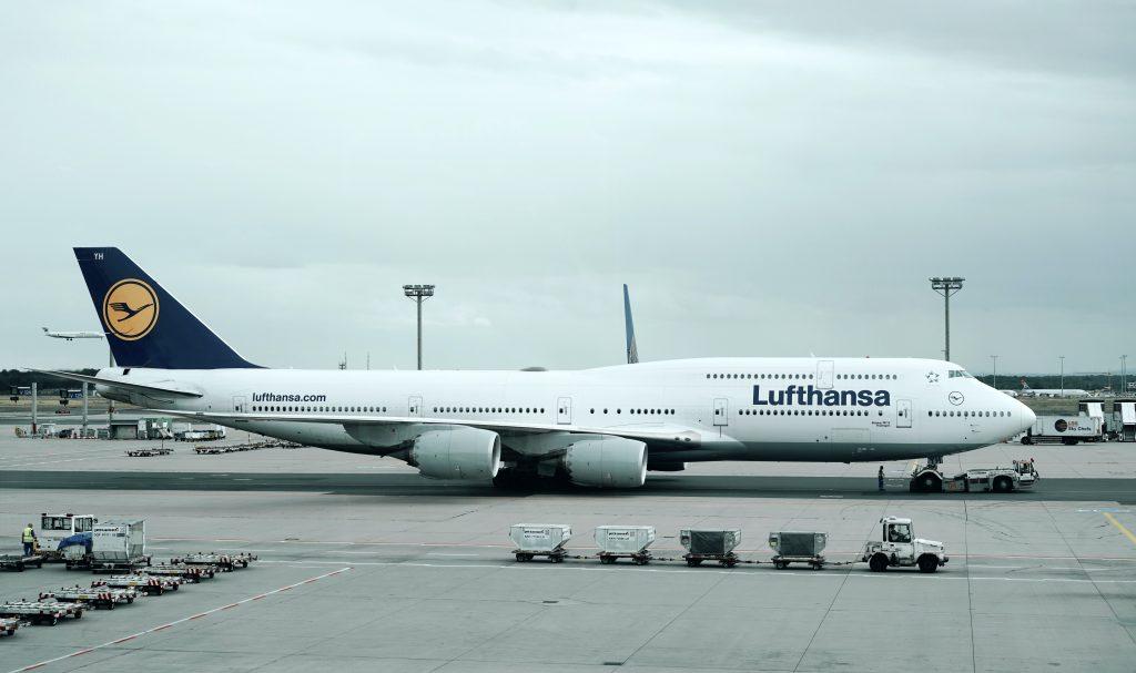 Lufthansa jumbo plane on airport tarmac
